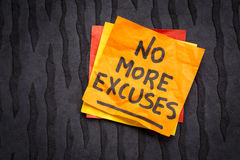 No more excuses - sticky note reminder. No more excuses! A motivational handwriting on a sticky note against black lokta paper Royalty Free Stock Photos