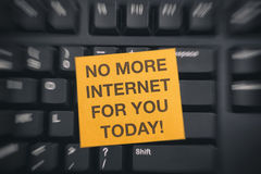 No More Internet For You Today!. Yellow paper note on black keyboard with writing  Blur effect Royalty Free Stock Photography