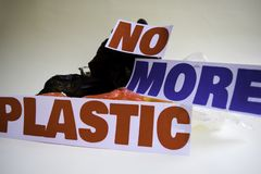 No more plastic message. It shows a plastic with motto and selective focus no more plastic text stock images