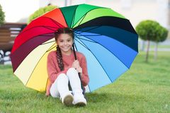 No more rain. Optimist and cheerful child. Spring rain. Positive mood in autumn rainy weather. Rainbow after rain. Little girl under colorful umbrella royalty free stock image