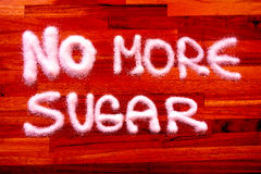 No more sugar sign. With wooden background Royalty Free Stock Image