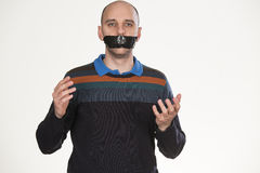 No more talking. Man gagged by tape Stock Photography