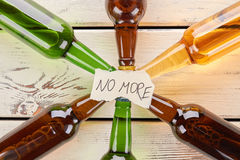 No more to alcohol drinking, concept. Paper message on collection of glass bottles Royalty Free Stock Image