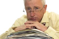 No more work for me please!. An exhausted businessman has had too much of his paperwork stock image