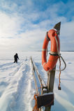 No need for lifebelt in frozen Baltic Sea. In February Baltic Sea is frozen due to long cold period. Platform is used for swimming during the summer time stock photos