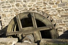 No need to reinvent the wheel !. Ancient millwheel under monumental protection Stock Photo