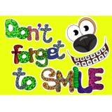 No olvide sonreír las palabras fijadas para la tarjeta de felicitación Imagen de archivo libre de regalías