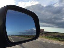 No one back there. A shot of a side mirror of a car showing clear road Stock Photography