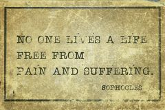 No one lives Soph. No one lives a life free from pain and suffering - ancient Greek philosopher Sophocles quote printed on grunge vintage cardboard Stock Photo