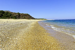 The Ionian sea washing gently over an empty beach in Kefalonia Royalty Free Stock Photos