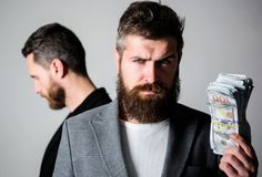 While no one watching. How recognize scam and protect yourself. Dishonest scheme. Scam and fraud concept. Scam and. Deception. Man bearded fraudster hold cash royalty free stock images