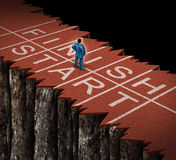 No Opportunity. And limited opportunities business concept as a lost businessman standing on a damaged separated track and field path as an adversity metaphor Royalty Free Stock Photos