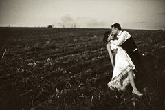 No ordinary love - groom kisses bride's forehead bending her ove Royalty Free Stock Photos