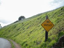 No outlet sign outdoors with path to left stock photography