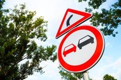 No overtake and three-cornered right turn sign Stock Photo