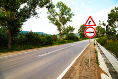 No overtake and three-cornered right turn sign Royalty Free Stock Images
