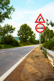 No overtake and three-cornered right turn sign. On a highway in Europe Royalty Free Stock Photos