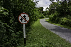 No Overtaking Sign Along Curve Road Stock Images