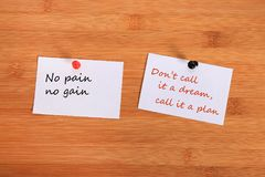 No pain no gain. Don`t call it a dream, call it a plan. Note pin on the bulletin board. No pain no gain. Don`t call it a dream, call it a plan. Note pin on the royalty free stock photos