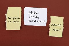No pain no gain. Make Today Amazing. Now or never! Note pin on the bulletin board. `No pain no gain.` `Make Today Amazing.` `Now or never!` Note pin on the stock photo