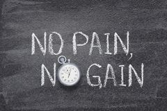 No pain, no gain watch. No pain, no gain phrase written on chalkboard with vintage precise stopwatch royalty free stock photo