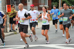 No pain, no gain. This picture was taken during Montreal marathon, September 5th, 2010. 22,000 runners were there stock image
