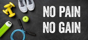 No pain no gain. Fitness equipment on a dark background - No pain no gain Royalty Free Stock Images