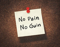 No pain no gain. On paper notepad Royalty Free Stock Photography