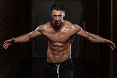 No Pain No Gain. Portrait Of A Physically Fit Man Showing His Well Trained Body royalty free stock image