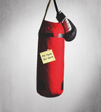 No pain no gain on punching bag. No pain no gain paper on the punching bag Stock Photography