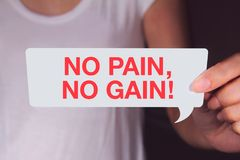 No pain, no gain wording with talk bubble. Suffering is part of living. Never give up royalty free stock photos