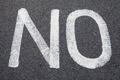 NO Painted on a Road Royalty Free Stock Photo