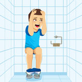 No Paper On Toilet Surprise. Young surprised man making shocked scared expression after noticing there is no paper on public toilet Royalty Free Stock Image