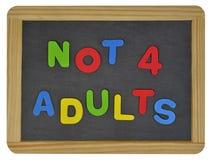 No para los adultos en letras coloreadas en pizarra Fotografía de archivo
