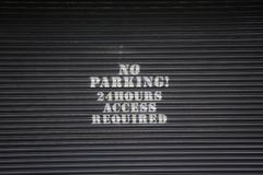 No parking. Sign on a garage door Stock Photo