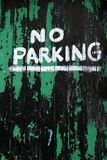 No Parking. Sign painted in white on an old green and black painted door Royalty Free Stock Photo