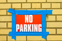 No parking. Sign taped to the wall royalty free stock images