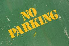 No parking. Grungy stenciled no parking sign Royalty Free Stock Photos