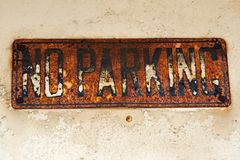 No Parking. Old rusty no parking sign Stock Photo