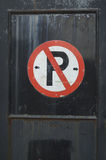 No Parking. Sign on distressed metal door Royalty Free Stock Photo