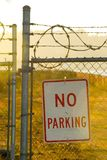 No Parking. Photo of a No Parking sign with barbed wire royalty free stock image