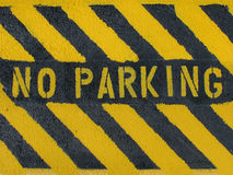 No Parking. A hand painted striped No Parking sign on blacktop pavement Royalty Free Stock Image