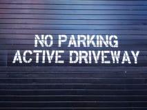 No Parking, Active Driveway stock image