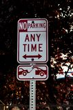 No parking any time tow away zone sign on a post stock image