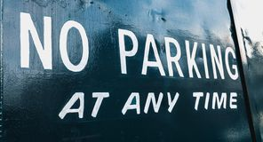 No parking at any time in white letter on a portal in the street stock photos