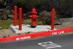 No Parking Fire Lane Exit. Most curbside fire hydrants have no parking signs in front of them Stock Image