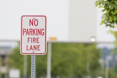 No parking fire lane sign close before a bridge royalty free stock image