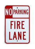 No Parking Fire Lane sign - Isolated. No Parking Fire Lane sign on a stucco wall - Isolated on white with clipping path royalty free stock image