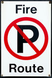 No Parking - Fire Route Sign. Universal no parking symbol sign with fire route notice text Stock Photography