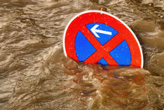 No parking in the flood, humorous scene. Humorous scene of a no parking traffic sign in a flood of brown water Stock Photo